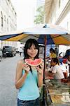 Thai woman with a slice of water melon, Bangkok,Thailand, Southeast Asia, Asia