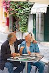 Senior tourists having breakfast in a local cafe, Rome, Lazio, Italy, Europe