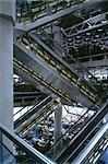 Lloyds Building, City of London, 1986. Escalators criss crossing the main atrium. Architect: Richard Rogers Partnership