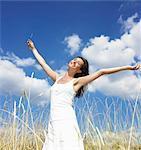 Woman in a field,  enjoying the sun