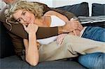 Arms around woman on sofa