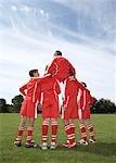 Footballer sitting on a teams shoulders