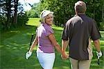 Illnesses paar Walking am Golfplatz