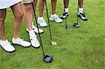 Close-up of Golfers' Feet