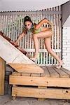 Portrait of young sexy African American woman in bikini posing in warehouse