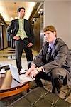 Portrait of multi-ethnic businessmen working in modern lobby