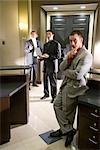 Portrait of multi-ethnic businessmen in modern lobby
