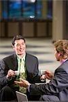 Portrait of multi-ethnic businessmen drinking coffee in modern lobby