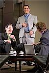 Portrait of multi-ethnic businessmen sitting in modern lobby