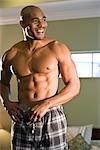 Portrait of smiling African American man in pajamas