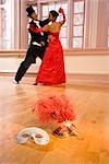 Elegant multi-ethnic couple ballroom dancing