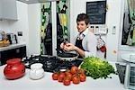 Man in Kitchen Cooking Dinner