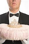 Butler Holding a Tiara on a Cushion