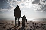 Father and Son on Beach in Winter, Lazio, Rome, Italy