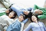 Family lying down on carpet