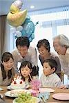 Three generation family celebrating birthday at home