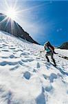 A female climber walking down a mountain