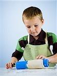 boy kneading dough