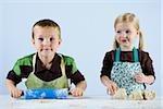 boy and girl kneading dough