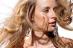 Close up landscape of blonde wind-blown hair