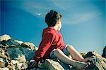 Little Boy Sitting on Rocks at the Beach, Harris Beach State Park, Brookings, Oregon, USA
