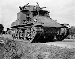 1930s 1940s WORLD WAR II ERA US ARMY TANK ONE MAN DRIVING WITH GUNNER