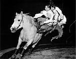 THREE MEN RIDING HORSE AROUND CIRCUS RING TRACK