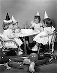 1960s GIRL QUADRUPLETS HAVING SECOND BIRTHDAY PARTY