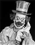 1950s PORTRAIT OF CLOWN WEARING TOP HAT SMILING INDOOR