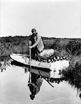 1930s 1940s SENIOR MAN STEERING SMALL BOAT FULL OF DUCK DECOYS SHOTGUN HUNTER HUNTING