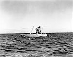 1940s 1930s SINGLE MAN HUNTER SMALL BOAT DEPLOYING DUCK DECOYS WATER