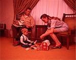1960s FAMILY IN LIVING ROOM