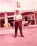 1960s GAS STATION ATTENDANT PORTRAIT FULL LENGTH