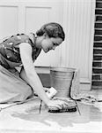 1930s 1940s WOMAN HOUSEWIFE KNEELING SCRUBBING DOORWAY FLOOR WITH BUCKET SOAP WATER AND BRUSH