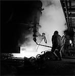 MEN WORKING IN STEEL MILL BLAST FURNACE MOLTEN METAL HOT HEAT HARD HAT WORK ALAN WOOD STEEL