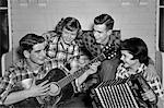1950s MUSIC QUARTET BAND TWO COUPLES TEEN BOYS GIRLS SINGING PLAYING GUITAR & ACCORDION WEARING PLAID SHIRTS