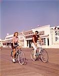 1950s TEEN COUPLE RIDING BIKES ON THE BOARDWALK JERSEY SHORE