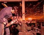 1970s MAN WORKING METAL SHOP SPARKS WELDING SANDING INDUSTRY WORKER WORKERS MEN