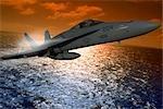 USN FA-18A HORNET FLYING OVER OCEAN AT SUNSET