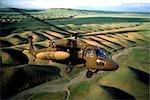 USAF BLACK HAWK HELICOPTER FLYING OVER HILLS