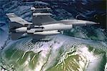USAF F-16 FALCON FLYING OVER OCEAN