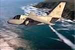 USN S-3 VIKING FLYING OVER OCEAN