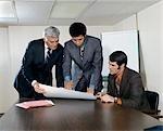 1970s MEN BUSINESS MEETING IN OFFICE