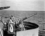 1940s WORLD WAR II BOFORS ANTI-AIRCRAFT GUN CREW ON US NAVY AIRCRAFT CARRIER