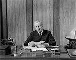 1940s MAN DESK BUSINESS PAPERWORK TELEPHONE TYPEWRITER