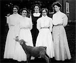 1900s TURN OF THE CENTURY GROUP OF FIVE WOMEN ONE HOLDING MILK BOTTLE FEEDING LAMB