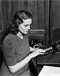 1940s WOMAN TYPING TYPEWRITER SECRETARY WORK BUSINESS