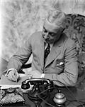 1930s MAN BUSINESS DESK WRITING TIE TELEPHONE