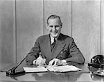 1940s MAN BUSINESS WORK PEN PAPERWORK TELEPHONE DESK SUIT