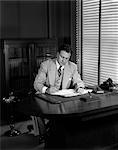 1950s BUSINESS DESK PEN WRITING MAN